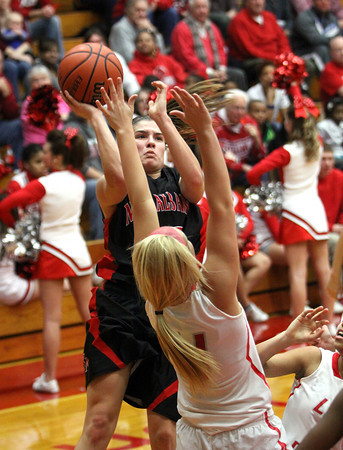 New Albany guard Tanner Marcum shoots a runner over Jeff defender Emily  Gray. Staff photo by C.E. Branham