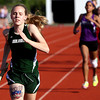 Floyd Central freshman Kassidy Manning leads the pack in the 4x800 relay at the Hoosier Hills Conference track and field meet on Tuesday. Staff photo by C.E. Branham