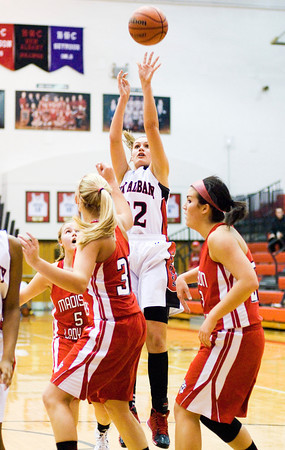 New Albany guard Lauren Camm goes up for a shot during the Bulldogs' 39-33 loss to Madison at home on Thursday. Staff photo by Christopher Fryer