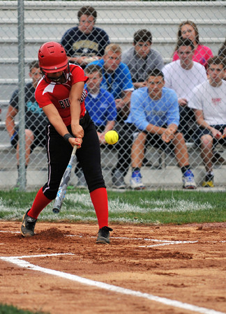 New Albany second baseman Kennedy Wynn connects for a triple during the Bulldogs' game against Providence Tuesday. New Albany took the 7-6 lead in the top of the seventh inning, but the game was suspended due to rain. <br /> Staff photo by Tyler Stewart