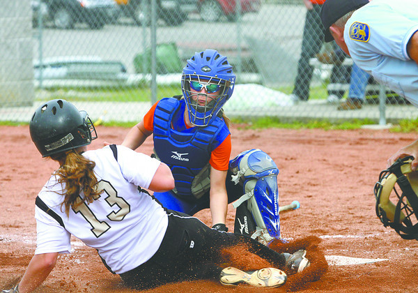 Silver creek catcher Lexi Kiper puts the tag on Henryville player Emily Hollis for an out Monday afternoon. Staff photo by C.E. Branham
