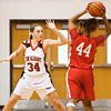 New Albany forward Claire Hirsch guards Evansville Bosse forward Gentell Esters during their game at New Albany on Saturday. New Albany lost the game, 57-41. Staff photo by Christopher Fryer
