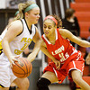Jeffersonville guard Chelsea Lewis steals the ball from Floyd Central guard Brooke Hinton during their game in the New Albany sectional tournament on Tuesday. Floyd Central won the game 62-48. Staff photo by Christopher Fryer