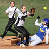 Henryville shortstop Cheyenne Mayfield waits for the throw as New Washington runner Ashley Johnson steals second base. Staff photo by C.E. Branham