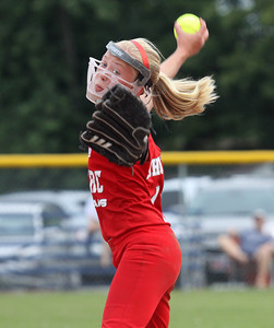 Juliette Schuur delivers a pitch for the  Jeff/GRC 11-12 All-Stars in the District V championship game Thursday night. Staff photo by C.E. Branham