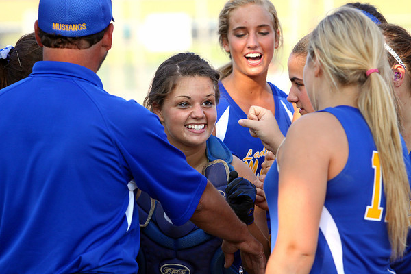 New Washington catcher Kayla Sexton fires up her teammates before going to bat in the bottom of the ninth inning. The Lady Mustangs scored for a 1-0 win over Lanesville in the championship game of the 1A Sectional. Staff photo by C.E. Branham