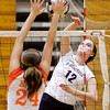 Providence sophomore Jacquie Hornung goes up for a shot during their match against Columbus East at the annual Providence Early Bird Invitational on Saturday. Columbus East won the match in three sets. Staff photo by Christopher Fryer