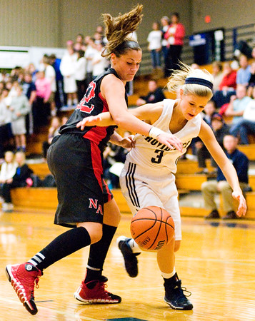 New Albany guard Lauren Camm and Providence guard Abby Hunt fight for a loose ball during their game at Providence on Friday. Staff photo by Christopher Fryer