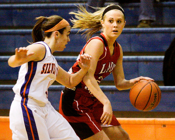 Borden's Shelby Kirchgessner drives past Silver Creek's Brooke Barnett during their game at Silver Creek on Thursday. Staff photo by Christopher Fryer