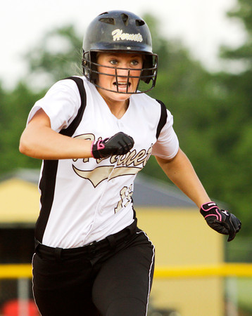 Henryville sophomore Kayla Wilson makes her way to third base during their game against Providence at the Eastern High School sectional tournament on Monday. Providence won the game, 10-9. Staff photo by Christopher Fryer