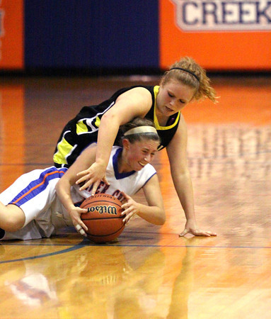 Silver Creek guard Lexi McFarland recovers a loose ball from Clarksville player Meranda Thierman Wednesday night. Staff photo by C.E. Branham
