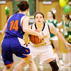 Floyd Central sophomore Maddie Probus covers Silver Creek junior Alexis Barnett during their game at Floyd Central on Thursday. Staff photo by Christopher Fryer
