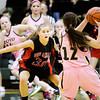 New Albany guard Jessica Knight covers Floyd Central guard Shelby Rost during their game at Floyd Central on Saturday. New Albany won the game, 54-46. Staff photo by Christopher Fryer