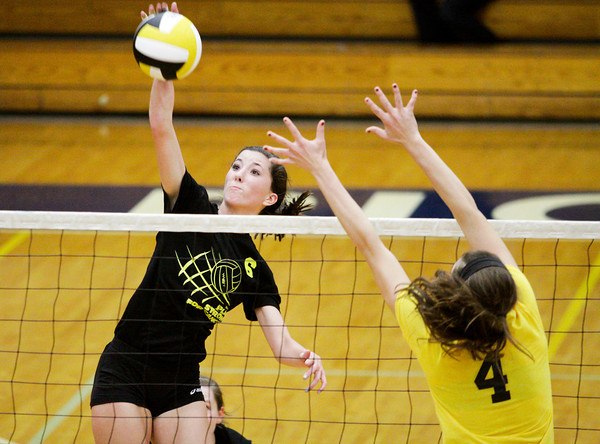 Providence sophomore Taylor Wilson attempts to hit a shot past Floyd Central junior Sydney Engle during their match at Providence on Tuesday. Floyd Central won the match in five sets. Staff photo by Christopher Fryer