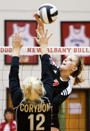 New Albany High School senior Catlin Lily hits the ball past Corydon Central High School junior Abigail Saulman during their match in the River City Invitational At New Albany on Saturday morning. New Albany won the match in two games. Staff photo by Christopher Fryer