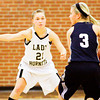Henryville guard Sadie Spears covers Providence guard Abby Hunt during the championship game of the Henryville Tipoff Tournament on Saturday. The Pioneers won the game, 63-37. Staff photo by Christopher Fryer