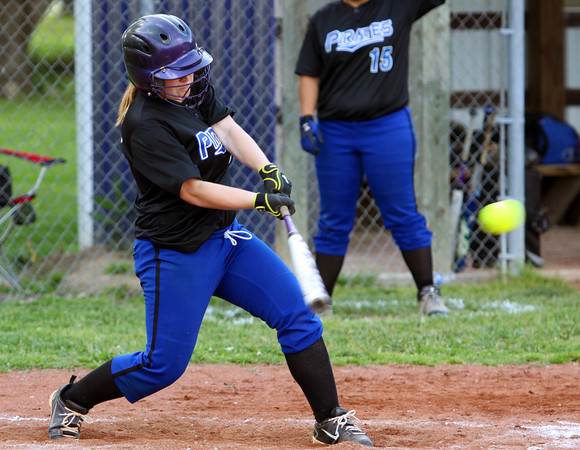 Charlestown Lady Pirate Shelby Goedeker drives in two runs with a single at New Washington on Wednesday. Staff photo by C.E. Branham