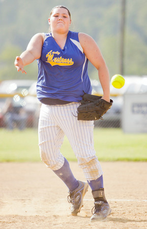 New Washington's Brooke Shaw pitches during the Mustangs' 1-0 loss in nine innings at Borden on Tuesday. Staff photo by Christopher Fryer