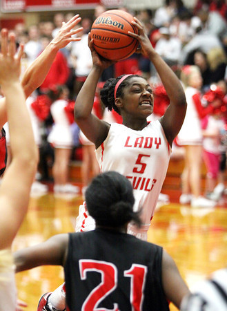 Jeff sophomore Nycia Ford drives against New Albany Friday night. Staff photo by C.E. Branham