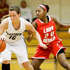 Jeffersonville guard Aurreeshae Hines covers Providence forward Taylor Smallwood during their game at Providence on Thursday. Jeffersonville won the game, 35-19. Staff photo by Christopher Fryer