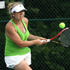 Floyd Central senior Carmen Schreiber playing No. 2 singles in the Regioanl final. Staff photo by C.E. Branham