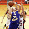 New Washington junior Caroline Ricks scores at New Albany Tuesday night. Staff photo by C.E. Branham