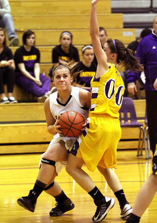 Henryville freshman Emily Hollis curls towards the basket against Eastern in the 2A Paoli Sectional. Staff photo by C.E. Branham