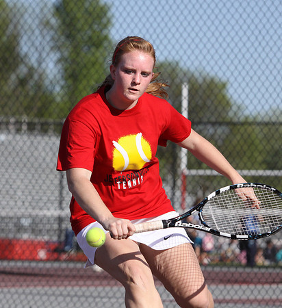 Jeffersonville High School No. 1 singles player Morgan Reilly returns volley in her match with Providence No. 1 singles player Jacqueline Hollkamp on Monday at Jeffersonville. Staff photo by C.E. Branham