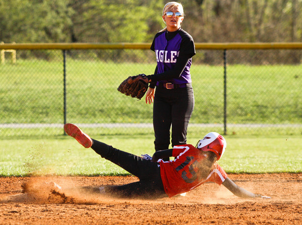 New Albany's Jena Fath slides safely into second base on a steal during their championship game against Lanesville in the New Albany softball invitational on Saturday. Staff photo by Christopher Fryer