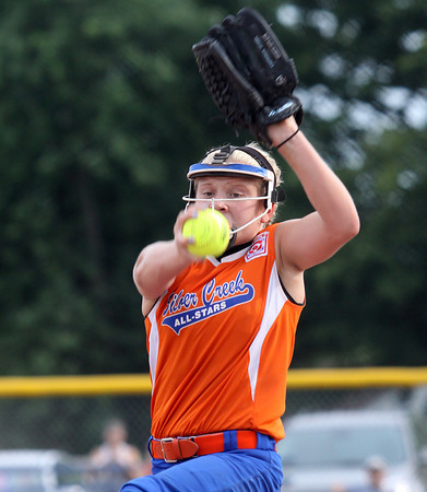 Lexie McAfee delivers a pitch for the Silver Creek 11-12 softball All-Stars in a 4-0 win over Jeff/GRC in the District V championship. Staff photo by C.E. Branham