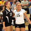 Henryville senior libero Jasmine Harrell, right, celebrates a point with teammate Emily Hollis in their 2A Sectional match against Clarksville Thursday night. Staff photo by C.E. Branham