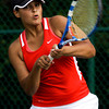 Jeffersonville High School junior Julianna Jenks returns the ball to Floyd Central High School junior Olivia Boesing during their No. 1 singles match at the Indiana High School Athletic Association Girl's Tennis Regional tournament at Floyd Central on Tuesday evening. Boesing won the match in two sets, 6-0, 6-0. Staff photo by Christopher Fryer