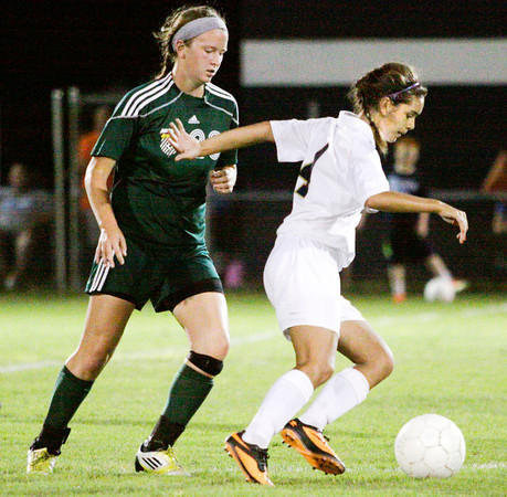 Providence midfielder Jordan Reger protects the ball from Floyd Central midfielder Presley Roos during their home game against Floyd Central on Tuesday. Floyd Central won the game 3-1. Staff photo by Christopher Fryer