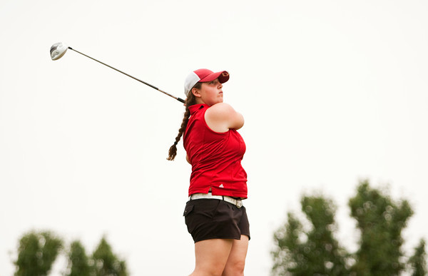 Borden's Tina Fink tees off on the first hole during the sectional tournament at Old Capital Golf Club in Corydon on Thursday. Staff photo by Christopher Fryer