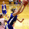 New Washington junior Brooke Abbott pulls down a rebound against Providence Tuesday night. Staff photo by C.E. Branham
