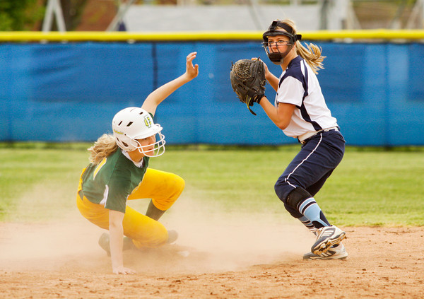 Providence's Morgan Boone looks to first after forcing Floyd Central's Regan Hadley out at second during their game at Providence on Friday. Floyd Central won the game, 7-0. Staff photo by Christopher Fryer