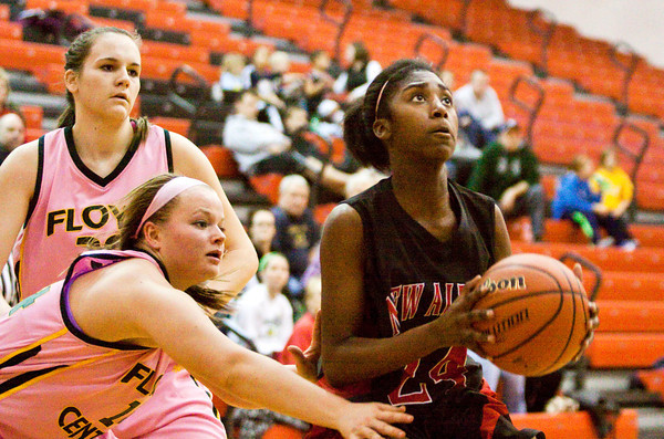 New Albany guard Aaliyah Bell drives the ball to the basket during their home game against Floyd Central on Saturday. New Albany won the game in double overtime, 69-64. Staff photo by Christopher Fryer