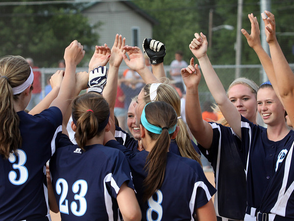 The Providence softball team celebrates a 14-4 2A regional championship win over Switzerland County. Staff photo by C.E. Branham