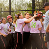 New Albany players congratulate Hannah Morton after she hit a home run during their home game against Providence on Tuesday. New Albany won the game, 3-0. Staff photo by Christopher Fryer