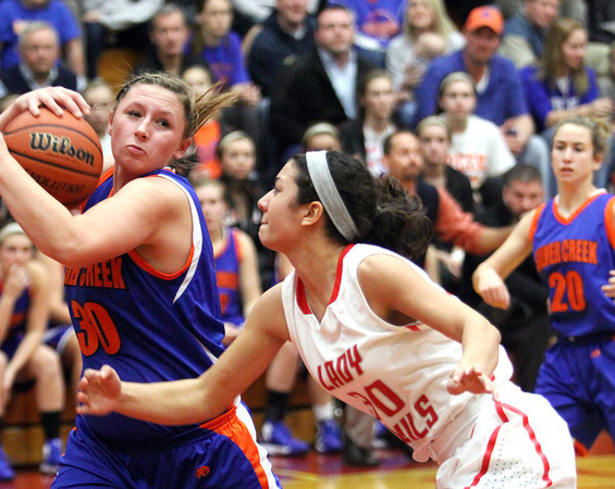 Silver Creek junior Casie Toby pulls in a rebound from Jeffersonville forward Hailey lacy Friday night at Jeff. Staff photo by C.E. Branham