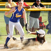 Borden's Riley Schindler safely slides into third base on a steal during the Braves' 1-0 win over New Washington in Borden on Tuesday. Staff photo by Christopher Fryer