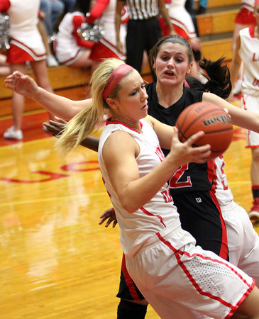 Jeff center Emily Gray pulls down a rebound against New Albany Friday night.  Staff photo by C.E. Branham