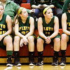 Floyd Central guards Brooke Hinton and Abbie Engle, left, and forwards Madison Kaiser and Tori Kingsley look on during the final minute of their championship game against Bedford North Lawrence in the New Albany sectional tournament on Saturday. Bedford North Lawrence won the game, 54-34. Staff photo by Christopher Fryer