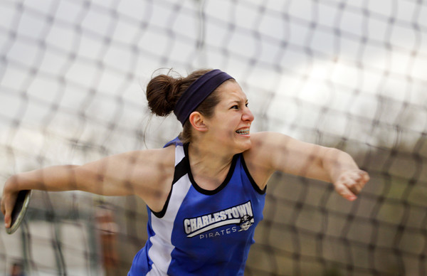 Charlestown junior Megan Brooks throws during the first flight of the discus competition during the Floyd Central Girl's Invitational track meet on Friday. Staff photo by Christopher Fryer