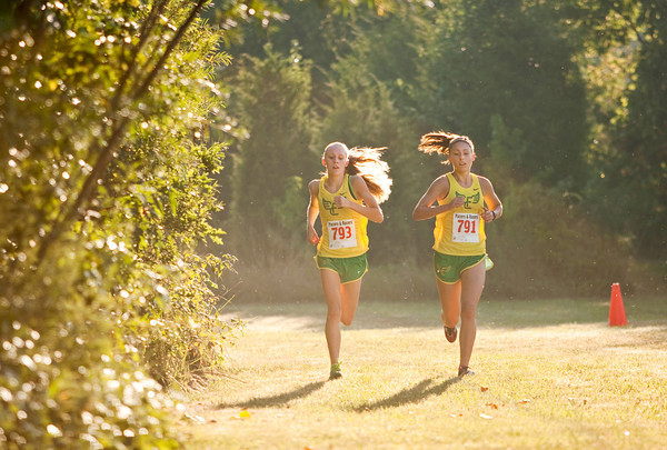 Floyd Central's Lydia Kotowski, right, and Kassidy Manning make their way through the course during the women's race of the Bulldog Classic cross country invitational in New Albany on Saturday morning. Kotowski finished in first place and Manning came in second. Staff photo by Christopher Fryer