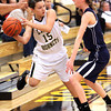 Henryville guard Bethanie Harbold looks for a outlet after being trapped by a Oldenburg Academy defender Saturday night. Staff photo by C.E. Branham