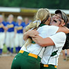 Highlander second baseman Taylor Batliner lifts fellow senior Morgan Harper in celebration after Floyd Centrals' 7-0 win over Castle in the Class 4A regional Tuesday evening. <br /> Staff photo by Tyler Stewart
