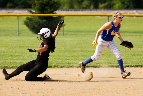 Borden's Kristen Nestor slides safely into second base after New Washington's Kaelin Williams missed the tag during the Braves' 1-0 win over the Mustangs in nine innings in Borden on Tuesday. Staff photo by Christopher Fryer