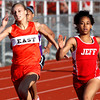 Jeffersonville sophomore Chelsea Lewis, right, wins her heat of the 200m dash at the Hoosier Hills Conference track and field meet Tuesday. Staff photo by C.E. Branham