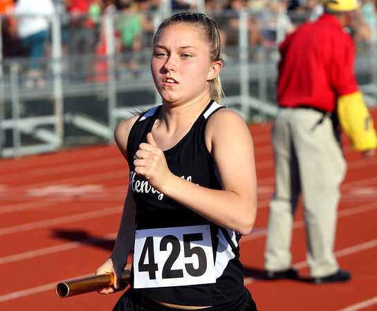 Henryville runner Mercedes Spears running the anchor leg of the 4x800 relay at the IHSAA Track and Field sectional Tuesday night. Staff photo by C.E. Branham